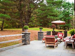 Rhinebeck property rental photo - Expansive fieldstone and bluestone terrace with new teak & hot tub on far end..
