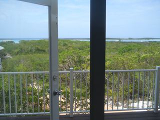 Long Island villa photo - .view of the rolling hills and the clarence town harbour from the livingroom