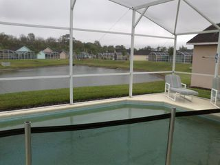 Town Centre Reserve house photo - Pool overlooks the lake for a wonderful relaxing evening view.