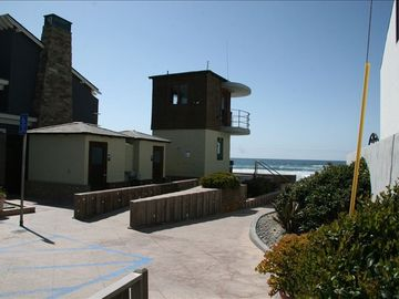 Life guard station, bathroom and showers at the end of 25th street.