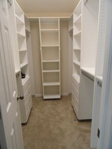 Custom walk-in closet in Master suite! There's room for everything!!