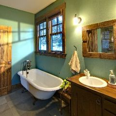 Black Mountain house photo - Master bath with claw foot tub and slate lined shower with glass enclosure.