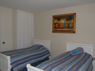 upstairs 2nd bedroom has twin beds and large closet