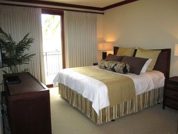 Master bedroom has a king size bed and large flat screen tv