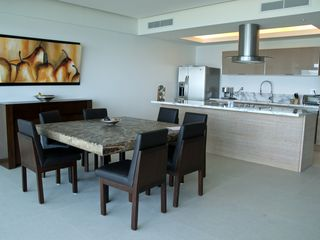 Nuevo Vallarta condo photo - Custom onyx table comes with 10 leather chairs for you and your guests.