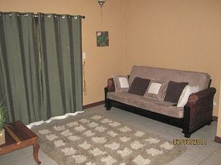 Playa Hermosa house photo - 2nd floor family room. Flat screen TV, futon, big ceiling fan, small deck