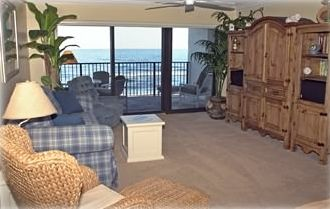 Spacious Living Room With Flat Screen LCD TV and Stunning Direct Ocean Views