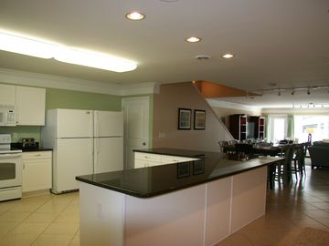 Another view of kitchen, there are 6 barstools not shown in photo.