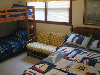 Oak Island house photo - The master bedroom. Queen size bed plus a set of bunk beds.