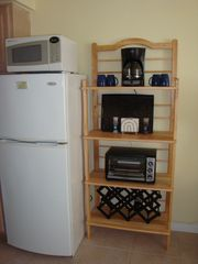 Wildwood Crest condo photo - Baker Rack: Coffee pot, toaster oven, and Wine Rack