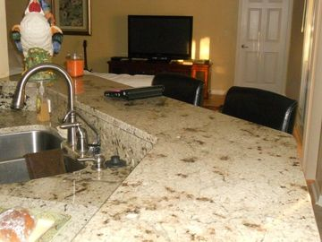 kitchen features high end fixtures and granite counter tops