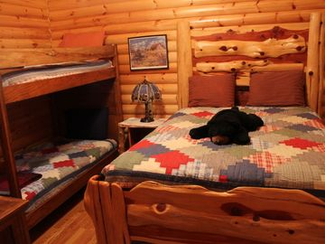 Guest bedroom with queen bed and bunk beds! Kids love the bunk beds!