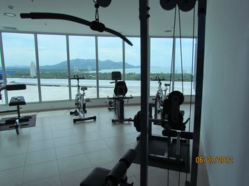 fully equipped fitness area with views and AC.