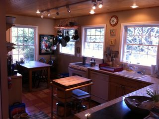 gourmet kitchen, tile counters, terra cotta floors