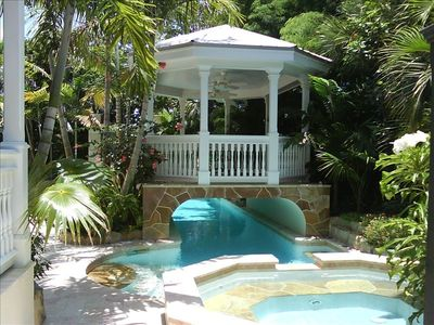 From the hot tub to the pool as you swim under the entertainment gazebo!