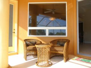 Cape Coral house photo - Lanai sitting area-just the place to enjoy a cool drink after a day on the water