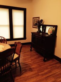 West Union house rental - Main level dining area features hard wood floor, round oak table, buffet.