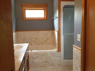 Utica house photo - Master suite offers jacuzzi tub & steam shower without having to leave the room