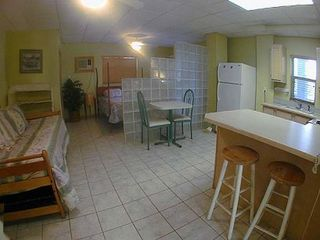 Summerland Key house photo - Apartment with kitchen, full bath, queen bed, day bed, TV, VCR, screened porch