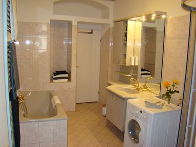 Large bathroom with bath tub and shower
