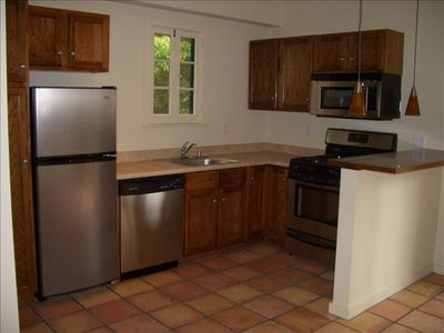 Studio City apartment rental - Kitchen - all stainless steel appliances, eating bar, art lighting, bar stools