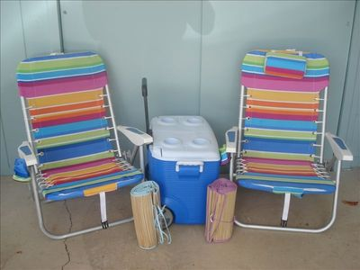 Beach chairs, beach mats, beach towels, and cooler to use at the beach