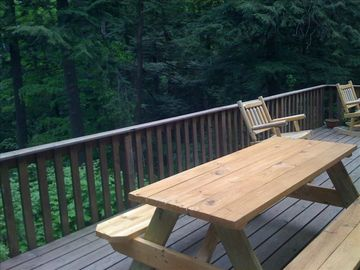 Back deck with view of lake BBQ, tables and rocking chairs