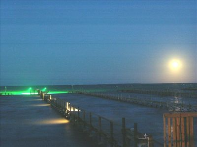 Full Moon rise with private pier lights on...great trout fishing!