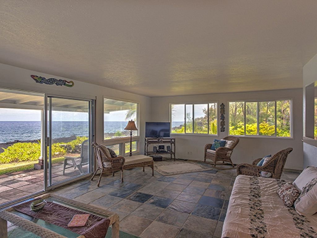 Oceanfront comfortable living room with rattan furnishings and Ocean view!