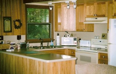 Fully equipped kitchen; hickory cabinets