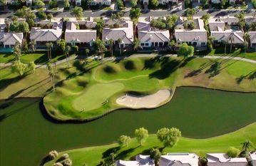 The Gorgeous 12th hole with our home just behind the green--
