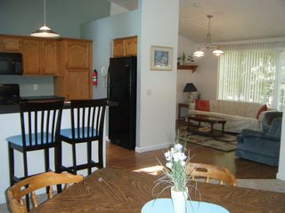 Saunderstown house photo - Open Kitchen with breakfast bar, dining, and living