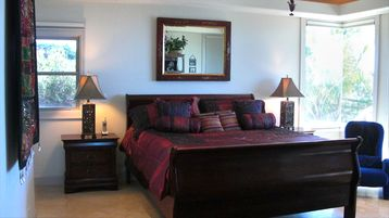 Master bedroom, walk out to pool access and ocean view from bed. In suite w/bath