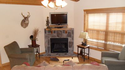 TV with DVD player and a gas fireplace for cozy nights in cooler weather.