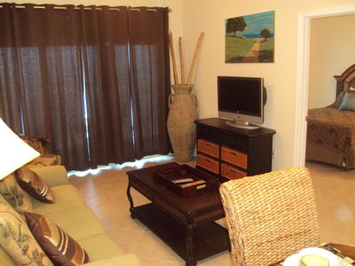 Enjoy the flat-screen television in the living area while at Crystal Towers!