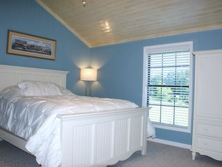 Milam lodge photo - Bedroom #3 features a Queen sized bed and 26 inch flatscreen TV.