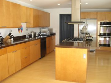 Gourmet kitchen with stainless steel appliances.