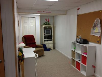 and play area with TV, video games, puzzles and desk for the kids.