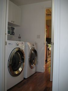 Washer Dryer are located inside the house, next to kitchen and garage