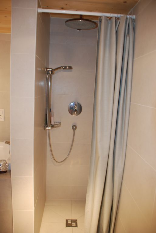The shower enclosure with rain shower