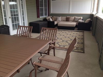 11x28 Front Porch!  12-13 people easily sit comfortably.  Great for young kids!
