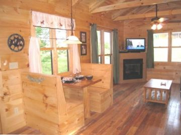 Jamestown cabin rental - Fireplace, Satellite TV with DVD, and cozy dining booth built for two.