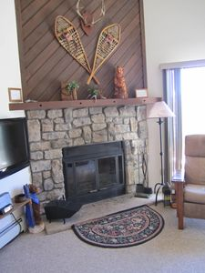 Fireplace with Antique Snow Shoes and Bears on Mantle.