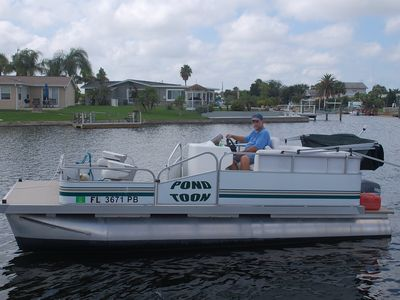 New 18 foot Pontoon tied to the dock in your back yard!
