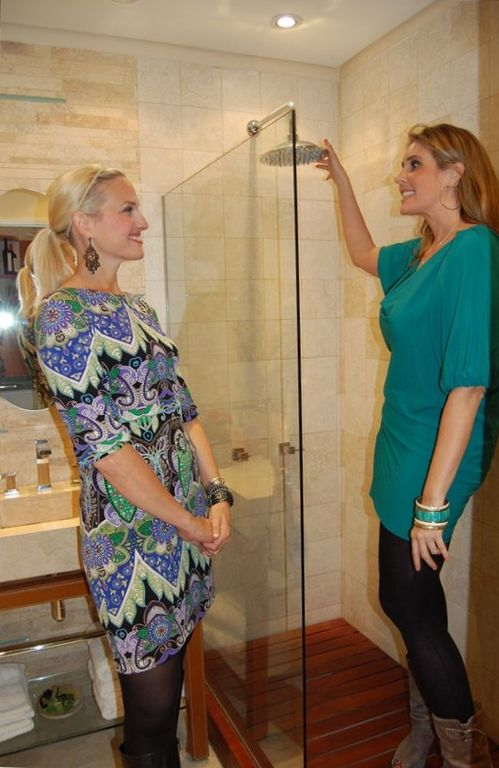 HGTV experts appreciating the master bathroom