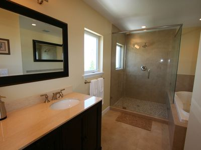 Master Bathroom with jetted tub walk in shower with an incredible view!