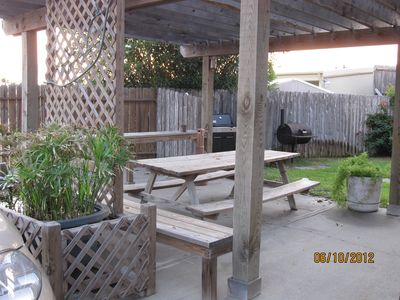 Port Aransas condo rental - Patio area has picnic table and both gas and charcoal grills