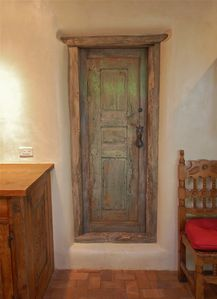 Old Mexican Door Leads to Second Double Bedroom