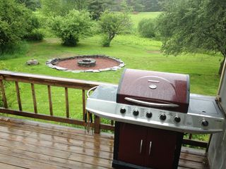 Lake Bomoseen estate photo - The new 5 burner BBQ and large stone fire pit in the rear yard.