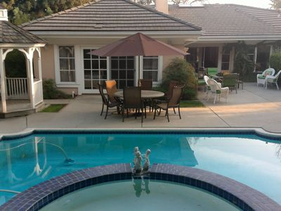 view of the heated pool and back yard... Enjoy!